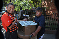 (171006RREI4434) Playing damas (checkers) at  La Esquina the corner of Mt. Pleasant St. and Kenyon St. NW. El Rana (right) Washington DC Oct. 6 ,2017 . ©  Rick Reinhard  2017     email   rick@rickreinhard.com