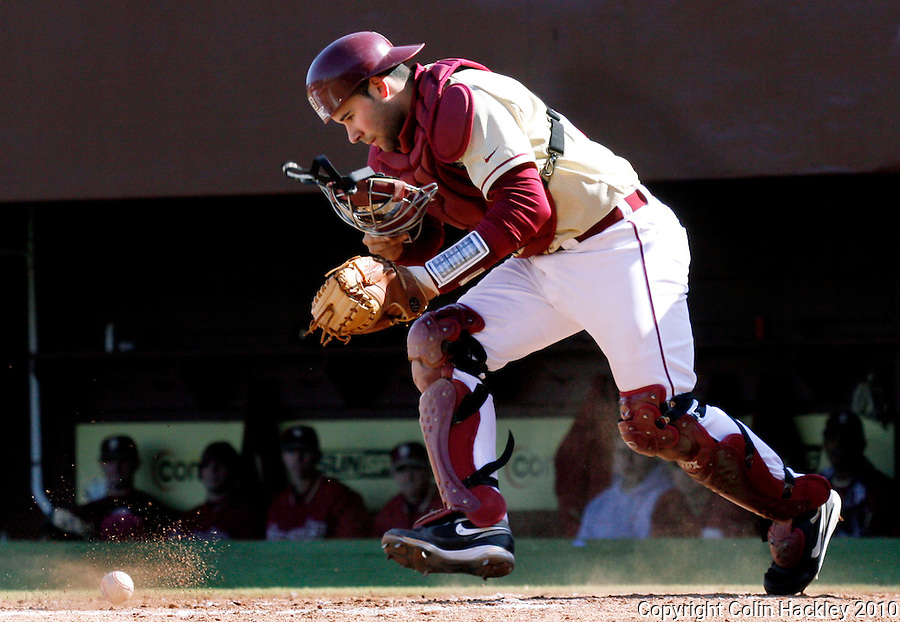 TALLAHASSEE, FL 2/13/10-FSU-BSB FANDAY10 CH43-Florida State catcher Parker Brunelle chases a ball during Fan Day Scrimmage action Saturday in Tallahassee...COLIN HACKLEY PHOTO