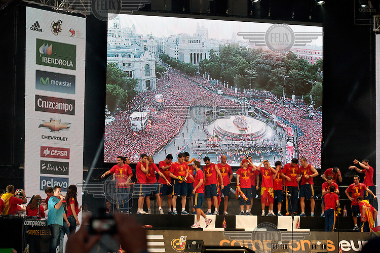 Players on a stage at the end of the victory parade of the Spanish national football team who won the UEFA EURO 2012 competition.