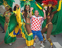 Germany, DEU, Dortmund, 2006-Jun-22: FIFA football world cup (USA: soccer world cup) 2006 in Germany; a Japanese football fan dancing together with a Brazilian samba group on his way to the world cup stadium.