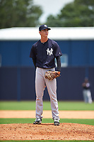 GCL Yankees East relief pitcher Aaron McGarity (21) looks in for the sign during the second game of a doubleheader against the GCL Yankees West on July 19, 2017 at the Yankees Minor League Complex in Tampa, Florida.  GCL Yankees West defeated the GCL Yankees East 3-1.  (Mike Janes/Four Seam Images)