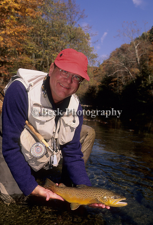 Lefty Kreh and a nice brown trout in the fall in PA.