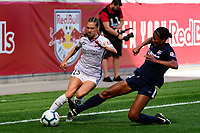 HARRISON, NJ - SEPTEMBER 29: Marisa Viggiano #23 of the Orlando Pride is defended by Imani Dorsey #28 of Sky Blue FC during a game between Orlando Pride and Sky Blue FC at Red Bull Arena on September 29, 2019 in Harrison, New Jersey.