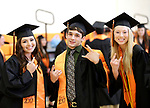 Terryville, CT- 21 June  2017-062117CM10-  Terryville High School graduates from left, Alycia Calabrese, Canaan Cossu-Fredericks and Jenna Covello pose for a photo during commencement exercises in Terryville on Wednesday.  Christopher Massa Republican-American