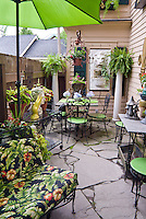 Small patio garden with house, shade, umbrella, garden furniture, pot containers, ornaments