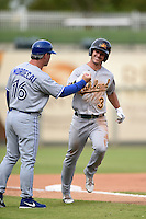 Mesa Solar Sox outfielder Boog Powell (3) is congratulated by manager Mike Mordecai (16) after hitting a home run during an Arizona Fall League game against the Peoria Javelinas on October 15, 2014 at Surprise Stadium in Surprise, Arizona.  Mesa defeated Peoria 5-2.  (Mike Janes/Four Seam Images)