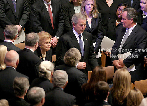 United States President George W. Bush escorts former first lady Betty Ford as she arrives for the State Funeral for former United States President Gerald R. Ford at the Washington National Cathedral, in Washington, D.C. on Tuesday, January 2, 2007..Credit: Ron Sachs / CNP.[NOTE: No New York Metro or other Newspapers within a 75 mile radius of New York City].