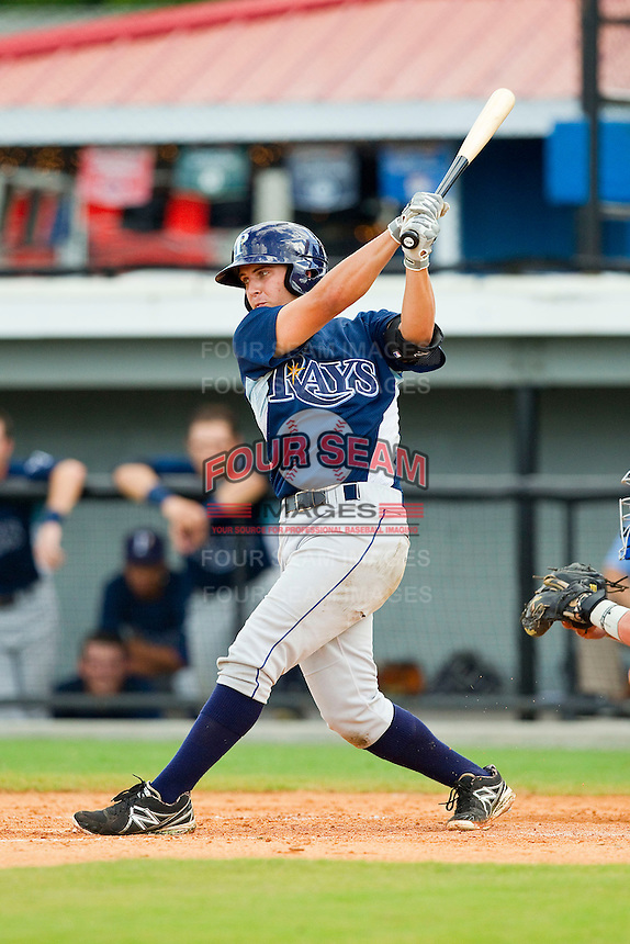Johnny Eierman (11) of the Princeton Rays follows through on his swing against the Burlington Royals at Burlington Athletic Park on July 5, 2013 in Burlington, North Carolina.  The Royals defeated the Rays 5-1 in game one of a doubleheader.  (Brian Westerholt/Four Seam Images)