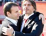FC Red Star head coach Aleksandar Kristic, right and head coach Alekeksandar Stanojevic, left, from Partizan, the Serbian League soccer match in Belgrade, Serbia, Saturday, October  24, 2010. (Srdjan Stevanovic/Starsportphoto.com)