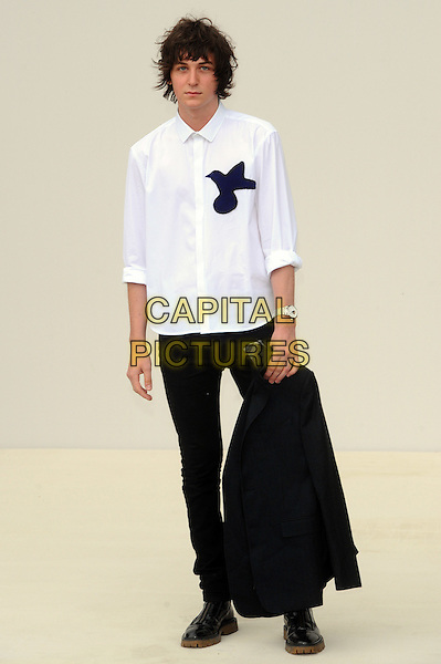 George Craig .London Fashion Week Spring/Summer 2012 - Burberry Prorsum - Arrivals.London, England..19th September 2011.LFW full length black jeans denim white shirt.CAP/CJ.©Chris Joseph/Capital Pictures.