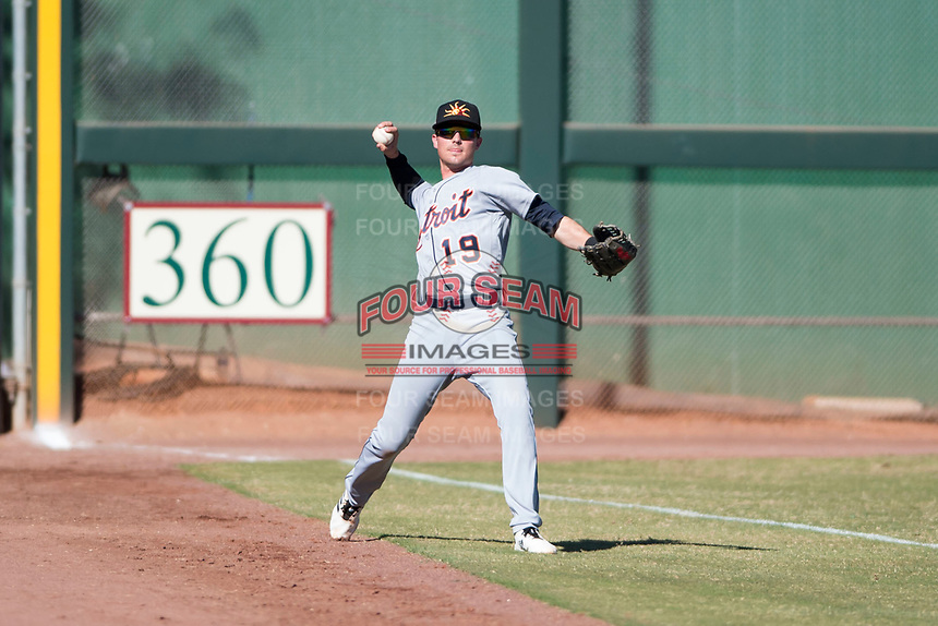 Mesa Solar Sox left fielder Daniel Woodrow (19), of the Detroit Tigers organization, throws to the infield during an Arizona Fall League game against the Scottsdale Scorpions at Scottsdale Stadium on November 2, 2018 in Scottsdale, Arizona. The shortened seven-inning game ended in a 1-1 tie. (Zachary Lucy/Four Seam Images)