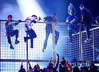 Travis Scott, center, climbs a cage during a performance at the 61st annual Grammy Awards on Sunday, Feb. 10, 2019, in Los Angeles. (Photo by Matt Sayles/Invision/AP)