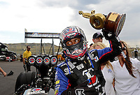 Jul, 22, 2012; Morrison, CO, USA: NHRA top fuel dragster driver Antron Brown celebrates after winning the Mile High Nationals at Bandimere Speedway. Mandatory Credit: Mark J. Rebilas-US PRESSWIRE