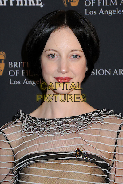 ANDREA RISEBOROUGH .17th Annual BAFTA Los Angeles Awards Season Tea Party held at the Four Seasons Hotel, Beverly Hills, California, USA, 15th January 2011..portrait headshot  white black sheer striped see thru through ruffles red lipstick make-up beauty .CAP/ADM/BP.©Byron Purvis/AdMedia/Capital Pictures.