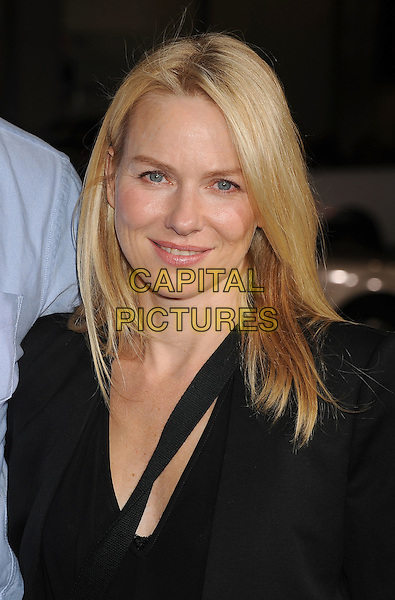 "NAOMI WATTS .arriving at the Los Angeles premiere of ""Paul"" at Grauman's Chinese Theatre in Hollywood, California, USA, .March 14th, 2011. .portrait headshot  black smiling beauty .CAP/ROT/TM.©TM/Roth/Capital Pictures"