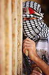 A masked Palestinian protester looks on during clashes with Israeli forces following a weekly demonstration against the expropriation of Palestinian land by Israel in the village of Kfar Qaddum, near the West Bank city of Nablus on September 7, 2018. Photo by Shadi Jarar'ah