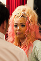Pomitan (24), store manager, talks with a member of staff of the Ganguro Cafe &amp; Bar in the Shibuya shopping area on September 4, 2015. <br /> <br /> Ganguro is an alternative Japanese fashion trend which started in the mid-1990s where young women, rebelling against the traditional idea of Japanese beauty, wore colorful make-up and clothes and had dark-skin.<br /> <br /> 10 Ganguro fashion girls work in the new bar, which offers original Ganguro Balls (fried takoyaki style sausage balls in black squid ink batter) on its menu. Ganguro Caf&eacute; &amp; Bar also offers special services such as Ganguro make-up and the chance to take purikura (photo booth pictures) with staff and to look like a Ganguro girl walking around the Shibuya streets.<br /> <br /> The bar is popular with both Japanese and foreigners and has menus translated in English. (Photo by Rodrigo Reyes Marin/AFLO)