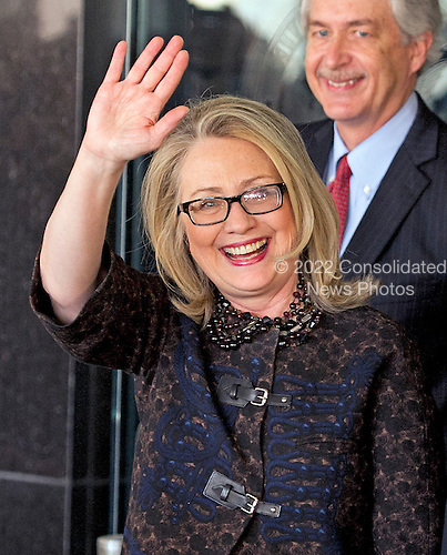 United States Secretary of State Hillary Rodham Clinton waves as she departs the State Department on her last day on the job in Washington, D.C. on Friday, February 1, 2013.  U.S. Deputy Secretary of State William J. Burns looks on from right..Credit: Ron Sachs / CNP.(RESTRICTION: NO New York or New Jersey Newspapers or newspapers within a 75 mile radius of New York City)
