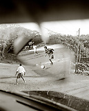 HONDURAS, Roatan, young teenagers playing soccer game (B&W)