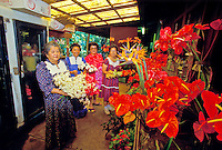 Four women showing their anthuriums and other flowers in a flower shop on the Big Island