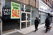Closed down shops on Kilburn High Road.