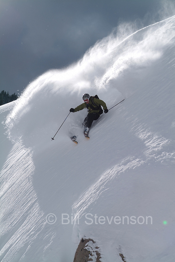A photo of a man skiing powder snow on Donner Summit in the Sierra.