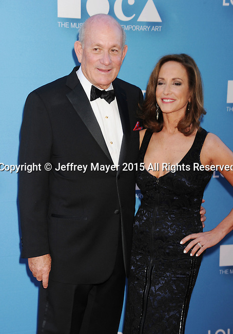 LOS ANGELES, CA - MAY 30: Philanthropist Bruce Karatz (L) and wife MOCA Gala chair, cancer activist Lilly Tartikoff arrive at the 2015 MOCA Gala presented by Louis Vuitton at The Geffen Contemporary at MOCA on May 30, 2015 in Los Angeles, California.