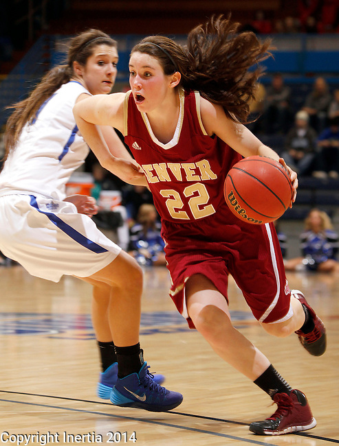 SIOUX FALLS, SD - MARCH 9:  Paige Bradley #22 from Denver  drives past Amanda Hyde #11 from IPFW in the second half of their game Sunday afternoon at the 2014 Summit League Basketball Tournament in Sioux Falls, SD. (Photo by Dave Eggen/Inertia)
