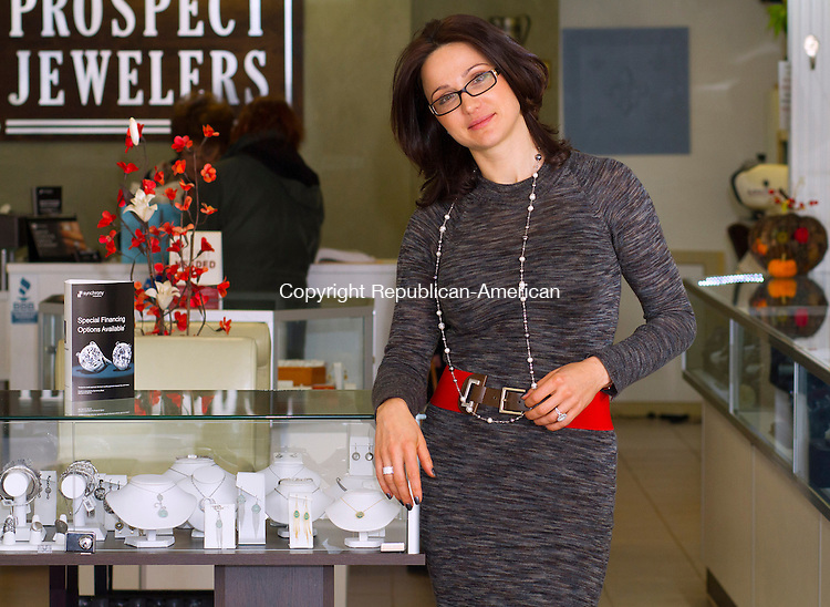 PROSPECT, CT. 29 NOVEMBER 2014 - 112914JW09 -- Prospect Jewelers owner Tanya Canfield poses for a photo in her store with a display of jewelery for sale.<br /> Jonathan Wilcox Republican-American