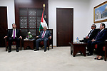 Palestinian President Mahmoud Abbas meets with official media staff, at his headquarters, in the West Bank city of Ramallah, on September 3, 2017. Photo by Osama Falah