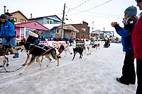 Lachlan Clarke mushes across the finish line in Nome during the 2010 Iditarod