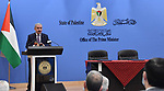 Palestinian Prime Minister Mohammad Ishtayeh, take part in launching the project of qualification and operation in the field of occupational safety and health and quality control for engineers in the West Bank city of Ramallah, on June 25, 2020. Photo by Prime Minister Office