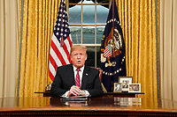 WASHINGTON, DC - JANUARY 08: U.S. President Donald Trump speaks to the nation in his first-prime address from the Oval Office of the White House on January 8, 2019 in Washington, DC. A partial shutdown of the federal government has gone on for 17 days following the president's demand for $5.7 billion for a border wall while Democrats have refused. Photo Credit: Carlos Barria/CNP/AdMedia