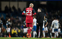 Goalkeeper Willy Caballero (Chelsea) of Argentina hands his glove to a young supporter who invades the pitch at full time during the International Friendly match between Argentina and Italy at the Etihad Stadium, Manchester, England on 23 March 2018. Photo by Andy Rowland.