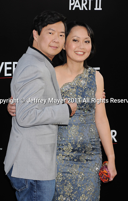 """HOLLYWOOD, CA - MAY 19: Ken Jeong and wife Tran Jeong arrive at the Los Angeles premiere of """"The Hangover Part II"""" at Grauman's Chinese Theatre on May 19, 2011 in Hollywood, California."""