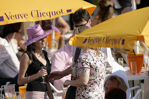 30 July 2004: Ladies enjoying a glass of champagne in the Champagne Bars at Goodwood Photo: Glyn Kirk/Action Plus...horse racing 040730 fashion dress hat hats