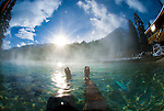 A young man soaks in the steamy waters of Granite Hot Springs near Jackson Hole, Wyoming.