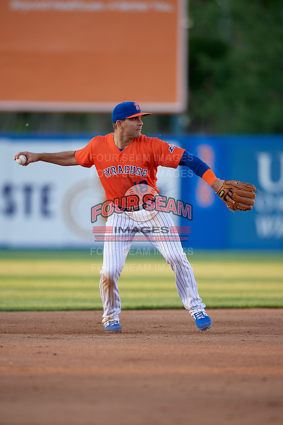 Syracuse Mets shortstop Danny Espinosa (18) throws to first base during an International League game against the Charlotte Knights on June 11, 2019 at NBT Bank Stadium in Syracuse, New York.  Syracuse defeated Charlotte 15-8.  (Mike Janes/Four Seam Images)