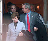 Washington, D.C. - February 19, 2006 -- United States President George W. Bush and first lady Laura Bush leave St. Johns Church in Washington, D.C. following Sunday morning services on February 19, 2006.   Reverend Spencer Rice, right (partially obscured by the President's shoulder), escorts the first couple from the church.<br /> Credit: Ron Sachs / CNP