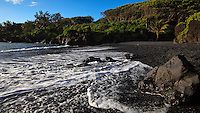 High tide at the black sand beach at Waianapanapa State Park on Maui in Hawaii