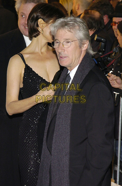 RICHARD GERE & CAREY LOWELL.Black tie gala benefit for amfAR, the foundation for AIDS research, at Cipriani on 42nd Street, New York, New York, USA..January 31st, 2007.half length black suit jacket scarf glasses bifocals dress married husband wife.CAP/ADM/BL.©Bill Lyons/AdMedia/Capital Pictures *** Local Caption ***