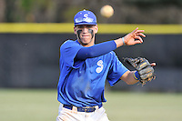 Shortstop Brent Burgess (8) of the Spartanburg Methodist College Pioneers warms up before a junior college game against Surry Community College on January 31, 2016, at Mooneyham Field in Spartanburg, South Carolina. (Tom Priddy/Four Seam Images)