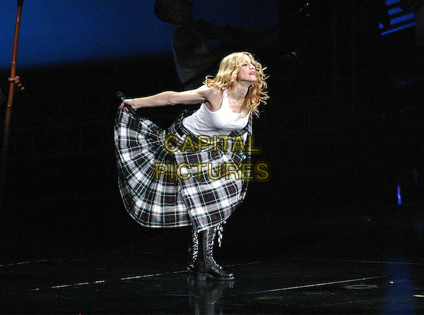 "MADONNA.On her ""Re-Invention"" tour performs live in concert at Madison Square Garden, New York,USA,.23rd June 2004..full length gig music on stage kilt white vest tartan.www.capitalpictures.com.sales@capitalpictures.com.©Capital Pictures"