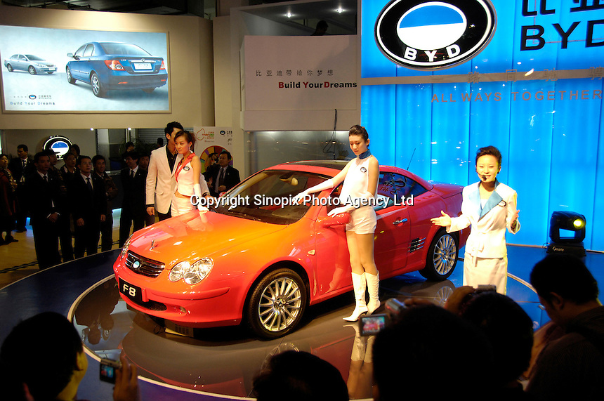 2006 Beijing Auto Show, models present the BYD F3e with rechargeable battery..19 Nov 2006