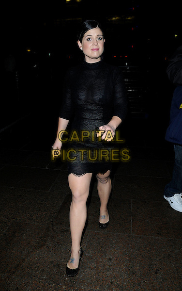 "KELLY OSBOURNE .Leaving the UK Premiere of the new Batman movie ""The Dark Knight"", Odeon Leicester Square, London, England, .July 21st 2008. .full length black dress shoes tattoo sheer lace.CAP/CAN.©Can Nguyen/Capital Pictures"