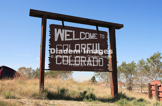 "A welcome sign at the Nebraska/Colorado border:  ""Welcome to Colorful Colorado."""