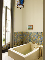 The 17th century tiles in the master bath are Portuguese and the lantern in Moroccan.