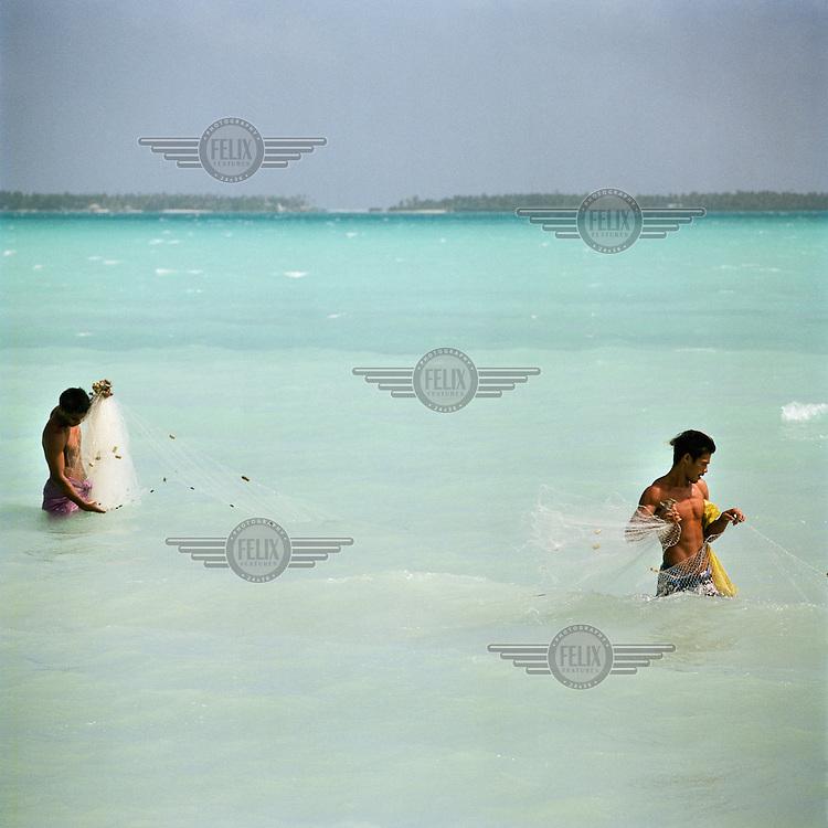 Men reef fishing in the lagoon.