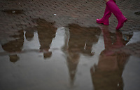 LOUISVILLE, KY - MAY 05: A woman wearing pink galoshes walks past a puddle on Kentucky Oaks Day at Churchill Downs on May 5, 2017 in Louisville, Kentucky. (Photo by Scott Serio/Eclipse Sportswire/Getty Images)