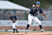 Asheville Tourists starting pitcher Helms Rodriguez (33) delivers a pitch during a game against the Greenville Drive on April 16, 2015 in Asheville, North Carolina. The Tourists defeated the Drive 5-4. (Tony Farlow/Four Seam Images)